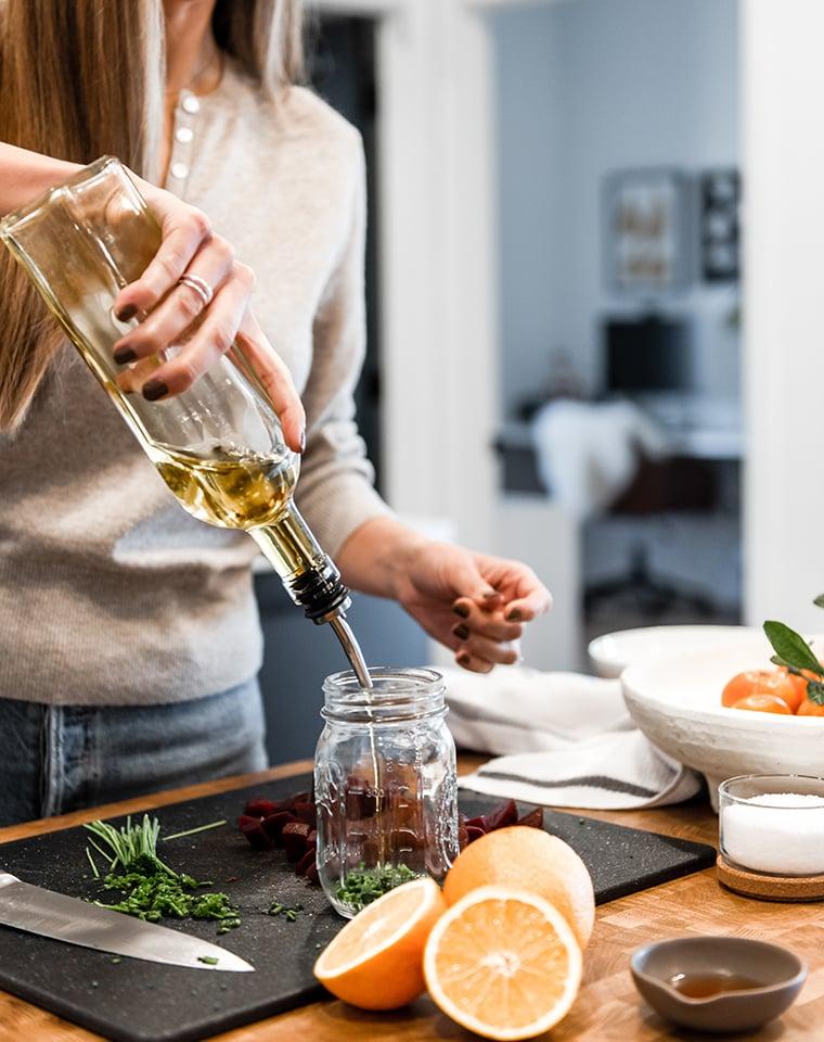 Lindsay pouring olive oil
