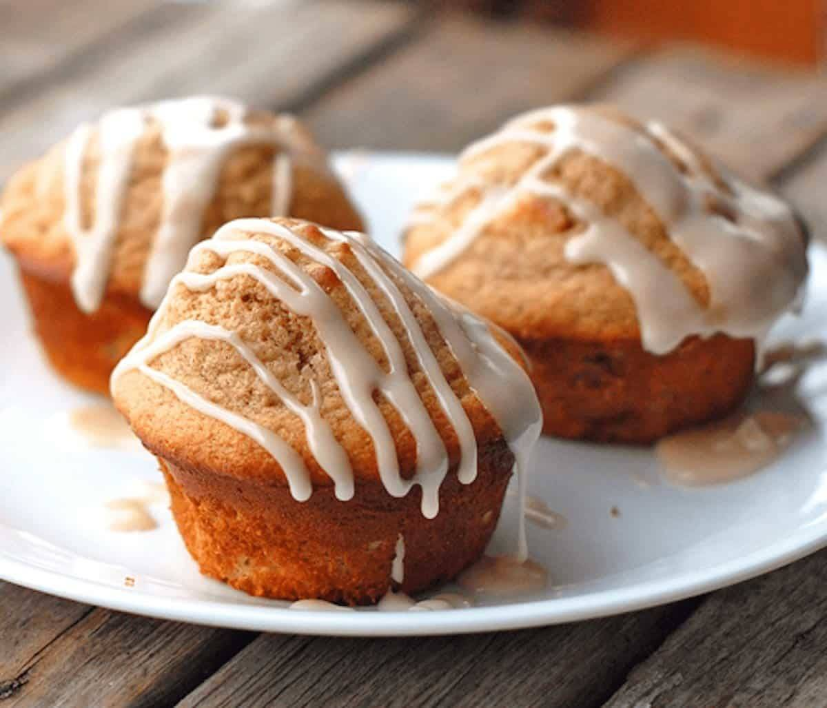 Apple cinnamon muffins topped with a warm vanilla glaze.