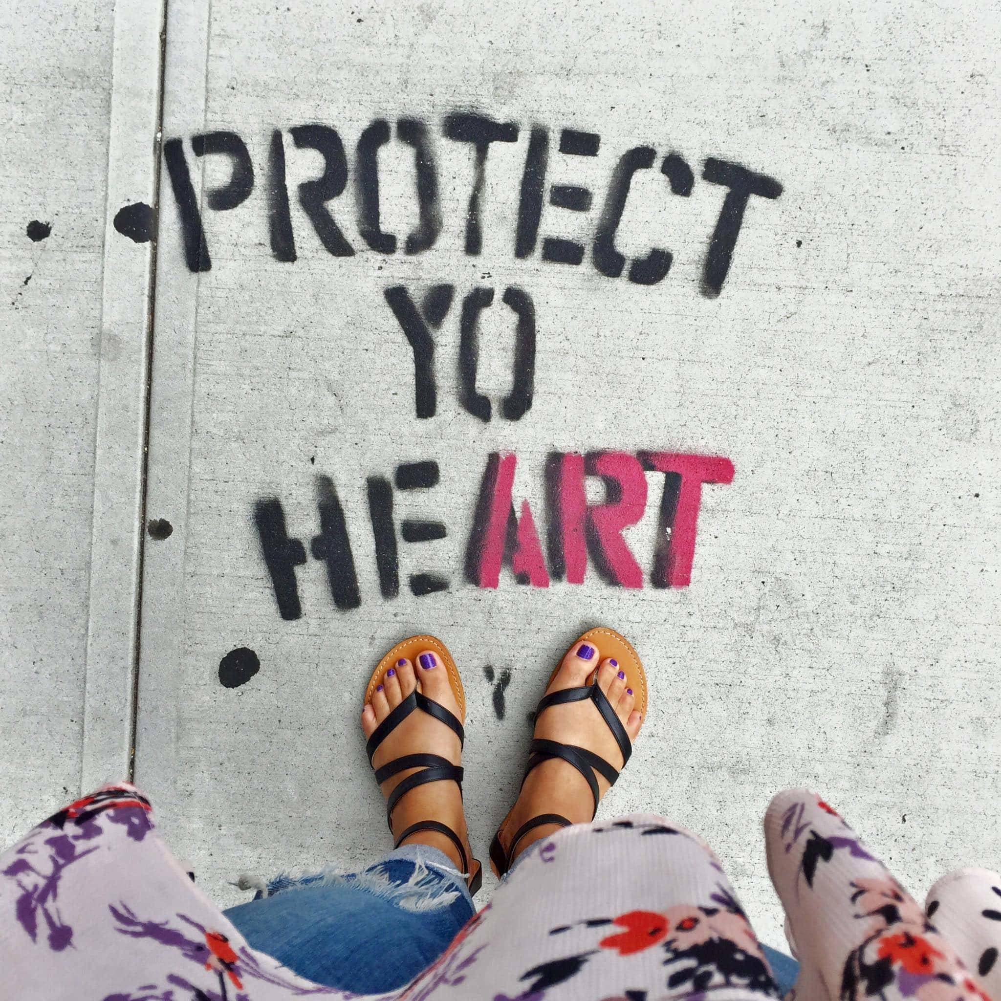 Protect Yo Heart on the sidewalk.