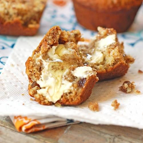 raisin bran muffins with honey and butter.