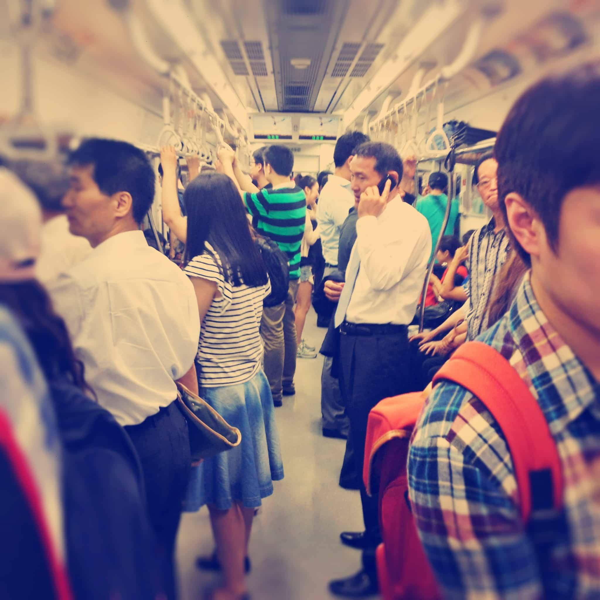 Train in Seoul filled with people.