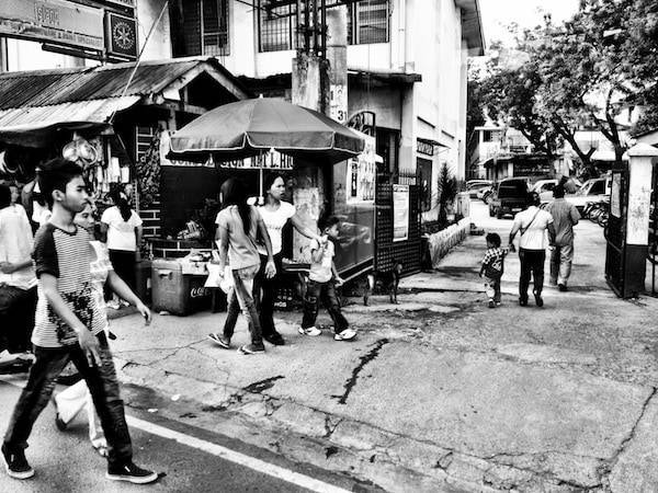 Black and white photo of people on a street.