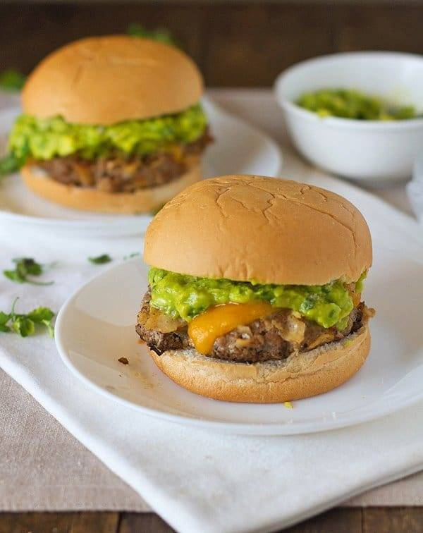 Southwest chipotle burgers with guacamole on plates.