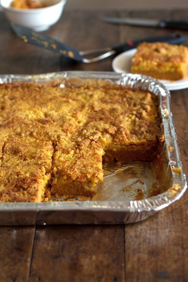 These pumpkin dessert bars are so easy! A yellow cake mix makes this a fast, simple, and totally addicting alternative to pumpkin pie. | pinchofyum.com