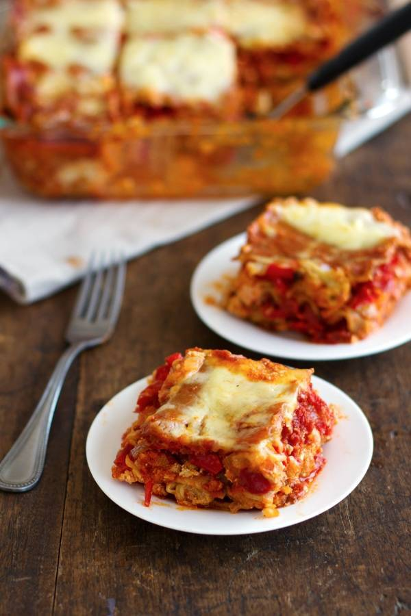 This whole wheat roasted veggie lasagna is loaded with roasted veggies, ricotta cheese, and soft whole wheat lasagna noodles. Yum! | pinchofyum.com