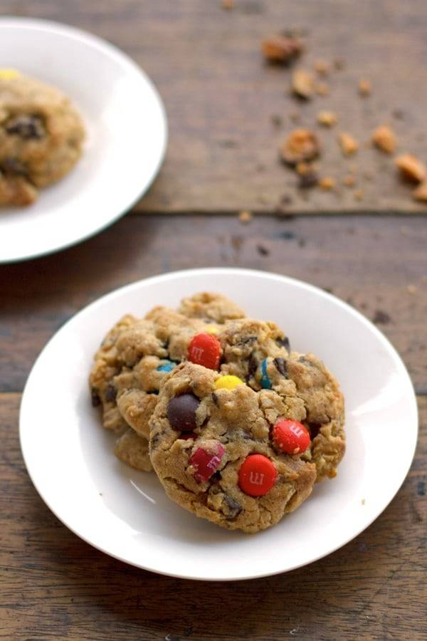 These Butterfinger monster cookies are so addicting! Made with peanut butter, M&Ms, and crushed Butterfinger candy bars. YUM. | pinchofyum.com
