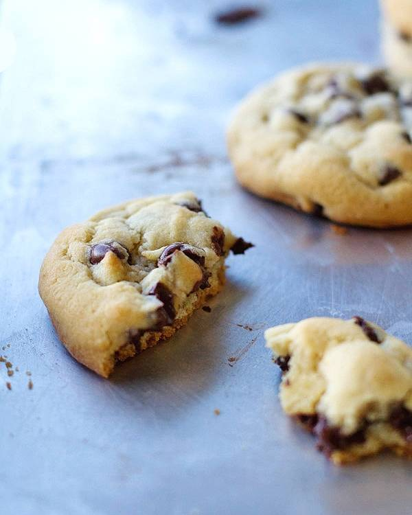Chocolate chip cookie pieces on a pan.