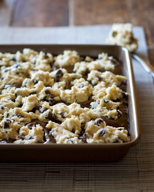 These easy chocolate chip cookie brownies have my very favorite chocolate chip cookie dough baked into the top layer of decadent, fudgy brownies. | pinchofyum.com