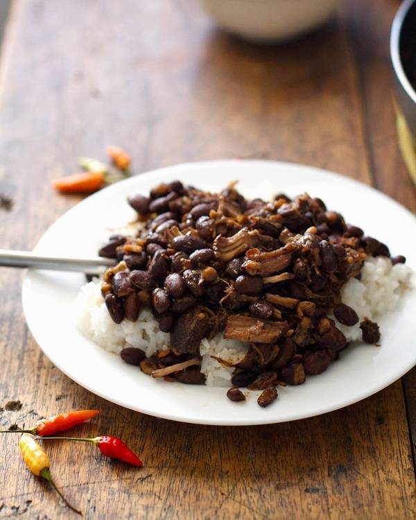 Crockpot Pork Adobo with Black Beans on a white plate.