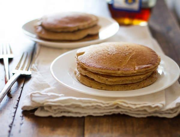 Whole wheat pancakes stacked on a plate.