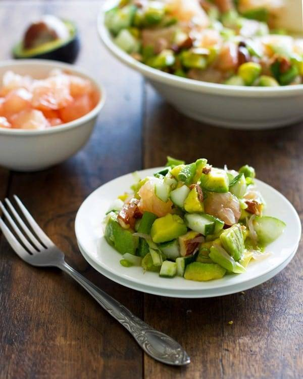 This avocado cucumber grapefruit salad is delicate, refreshing, and crunchy with smoked almonds and a honey vinaigrette. Perfect lunch! | pinchofyum.com