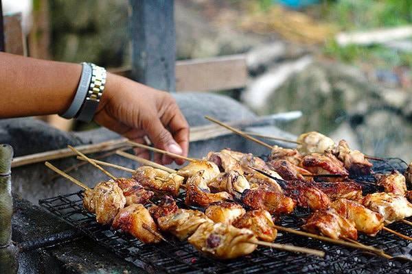Filipino chicken barbecue on a grill.