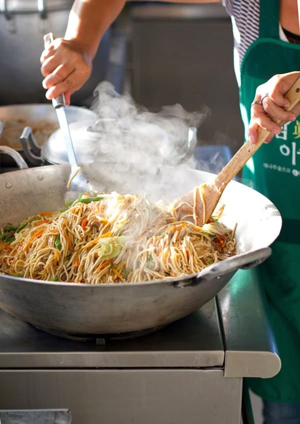 Filipino Pancit steaming in a pan.