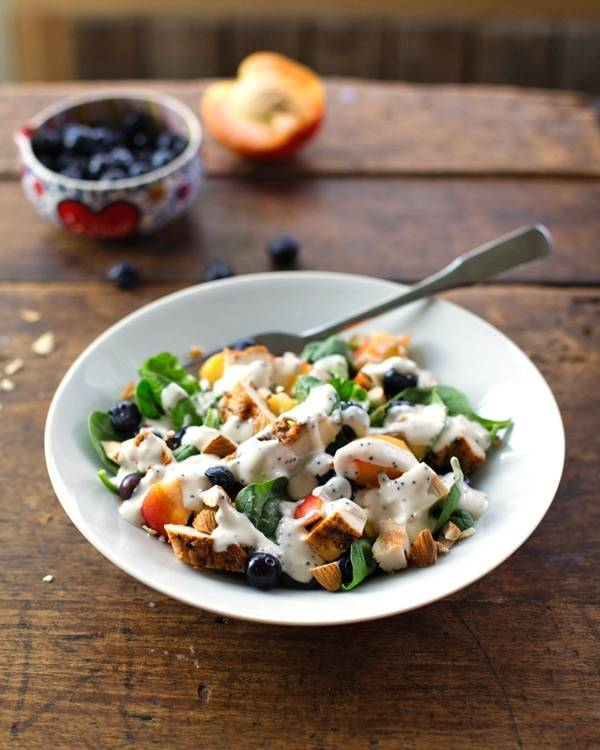 This chicken and nectarine poppy seed salad has grilled chicken, blueberries, nectarines, almonds, spinach, and homemade poppy seed dressing. | pinchofyum.com
