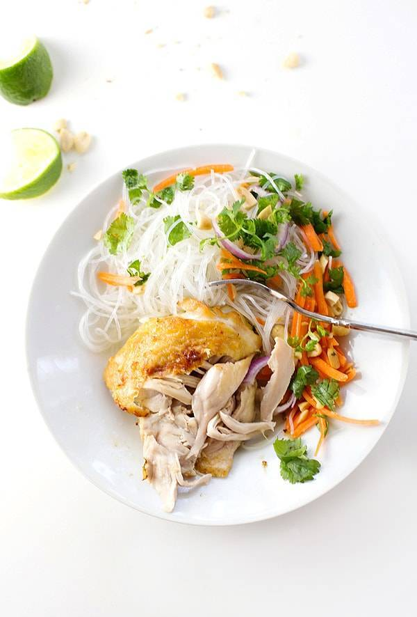 This coconut lime chicken is a perfect way to change up your weekly chicken dinner routine. Served with rice noodles and Thai-style garnishes. | pinchofyum.com
