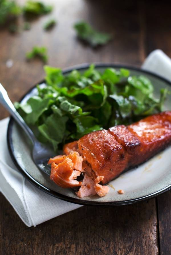 Caramelized salmon on a plate.
