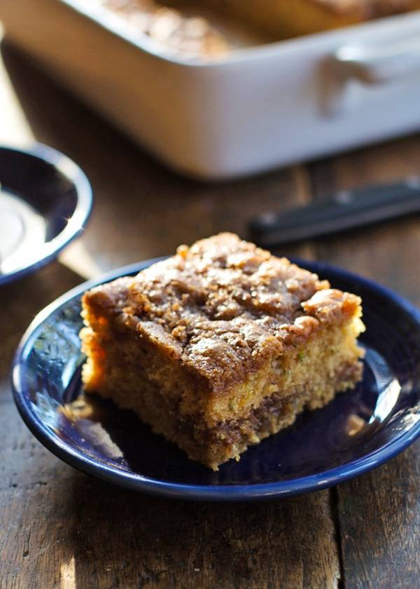 Cinnamon Sugar Zucchini Coffee Cake on a blue plate.