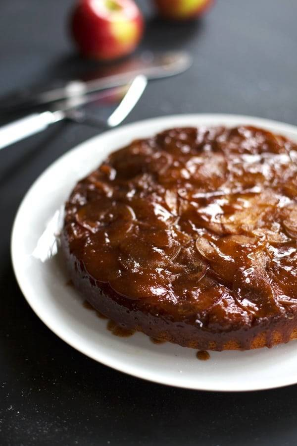 Salted Caramel Apple Upside Down Cake on a white plate.