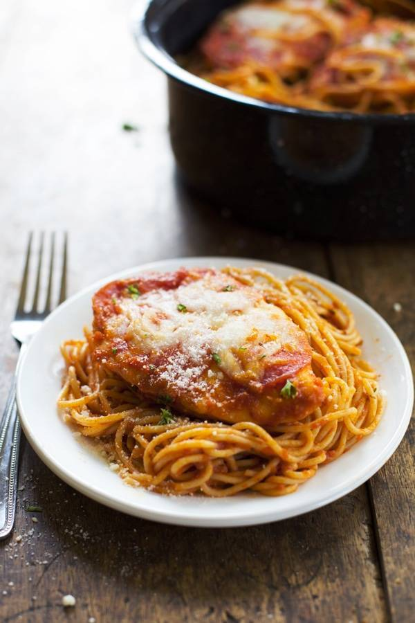 This 6-ingredient recipe for Chicken Pizzaiola is a family favorite! Spaghetti noodles with pepperoni and cheese covered chicken. Yum! | pinchofyum.com