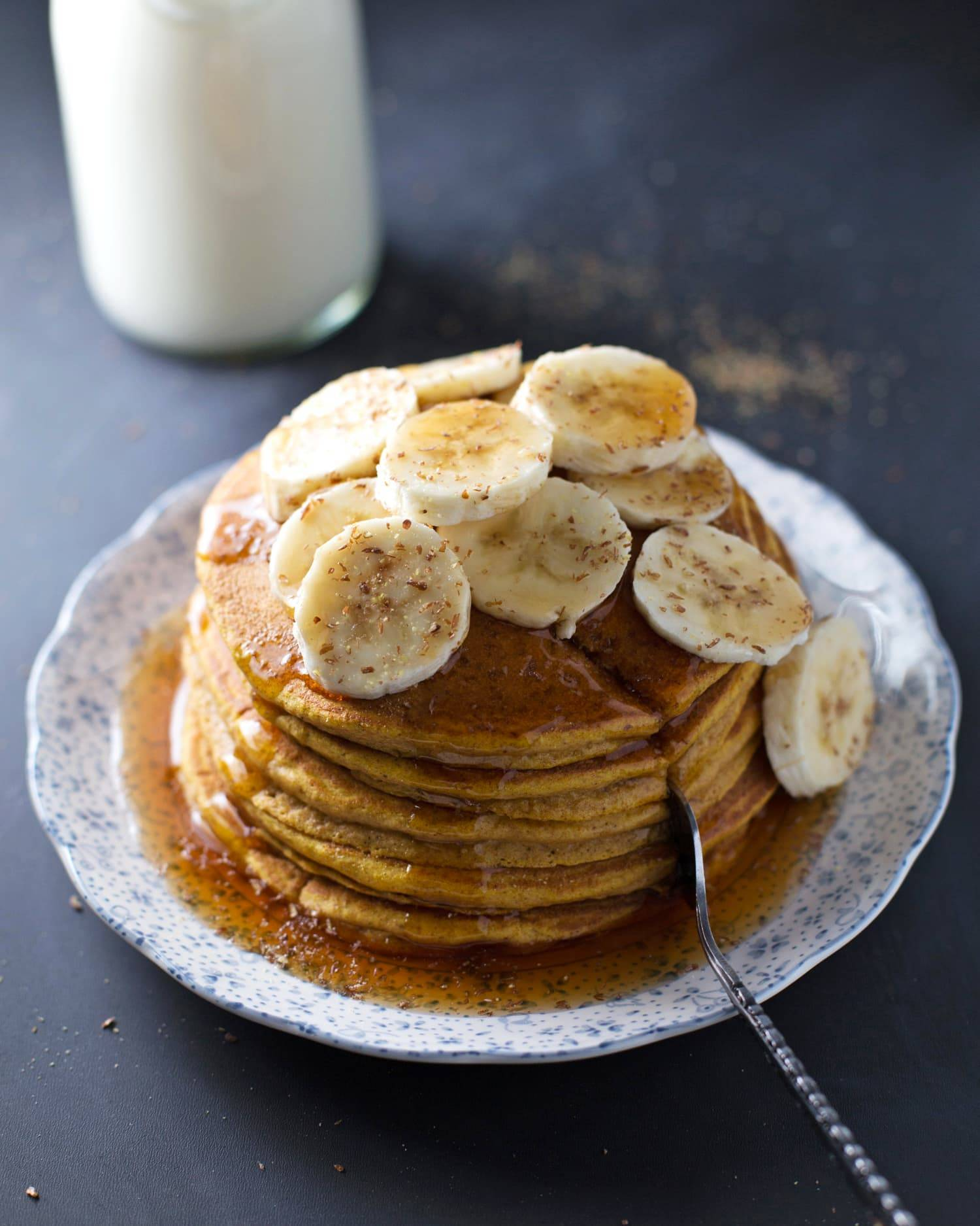 These whole wheat pumpkin pancakes are truly the best ever. Light and fluffy and full of whole wheat pumpkin goodness. Yum! | pinchofyum.com