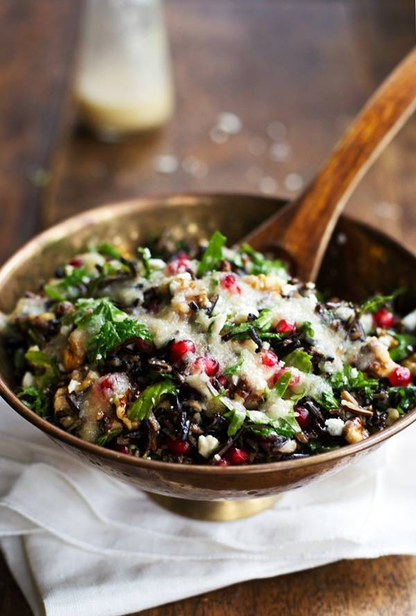 Pomegranate, Kale, and Wild Rice Salad, with walnuts and Feta cheese and a simple homemade dressing. So healthy, so good! | pinchofyum.com