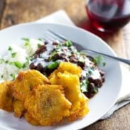 Garlic Tostones: Puerto Rican Fried Plantains with Rice and Beans