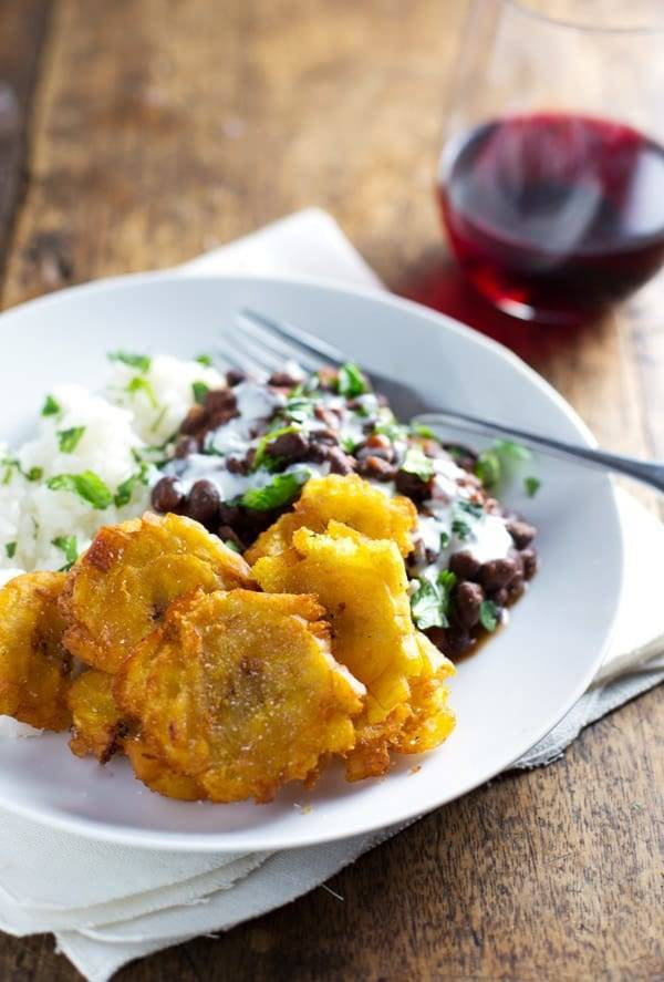 Garlic tostones puerto rican fried plantains with rice and beans garlic tostones on a white plate with rice and beans forumfinder Images