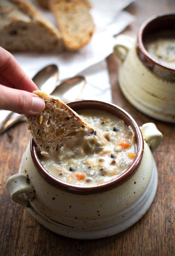 This Crockpot Chicken Wild Rice Soup is so darn simple to make and goes perfectly with a piece of crusty bread on a cold winter night. | pinchofyum.com