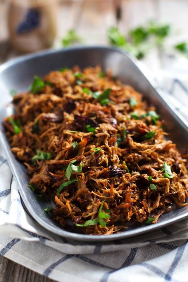 This Super Easy Slow Cooker Pork goes with anything and can be made with a short ingredient list! Includes a trick for browning the meat to perfection. | pinchofyum.com