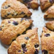Bakery Style Blueberry Scones - crunchy sugaroutside, juicy blueberries + flaky tender inside. | pinchofyum.com