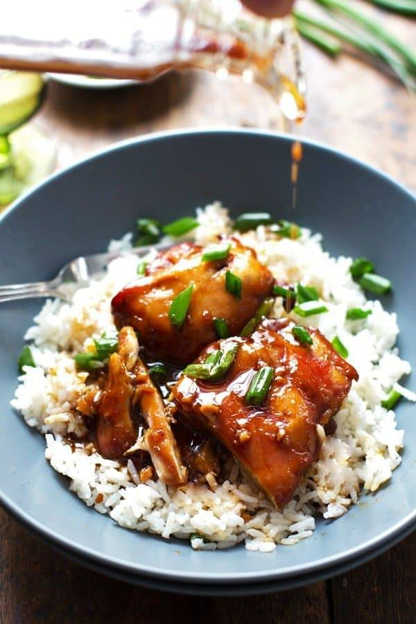 Sticky Bourbon Chicken with Rice in a grey bowl.