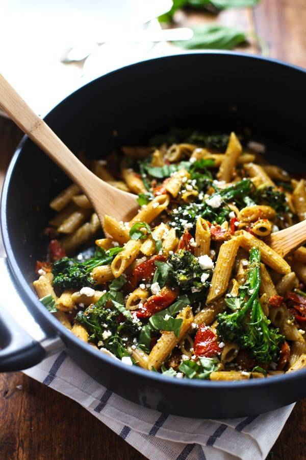 Lemon Pesto Penne in a pan with a wooden spoon.