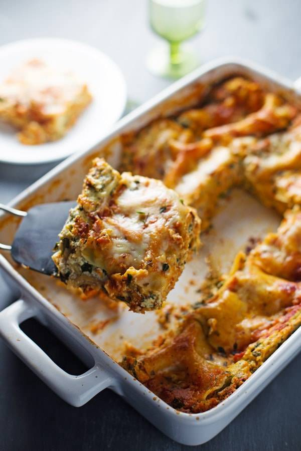 This Skinny Spinach Lasagna has thick layers of sauce, noodles, ricotta, spinach, and Mozzarella - queue the mouth watering! | pinchofyum.com