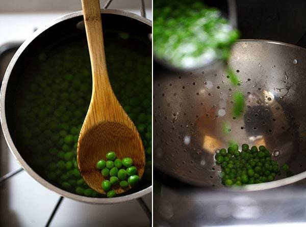 Green peas on a wooden spoon and in a colander.