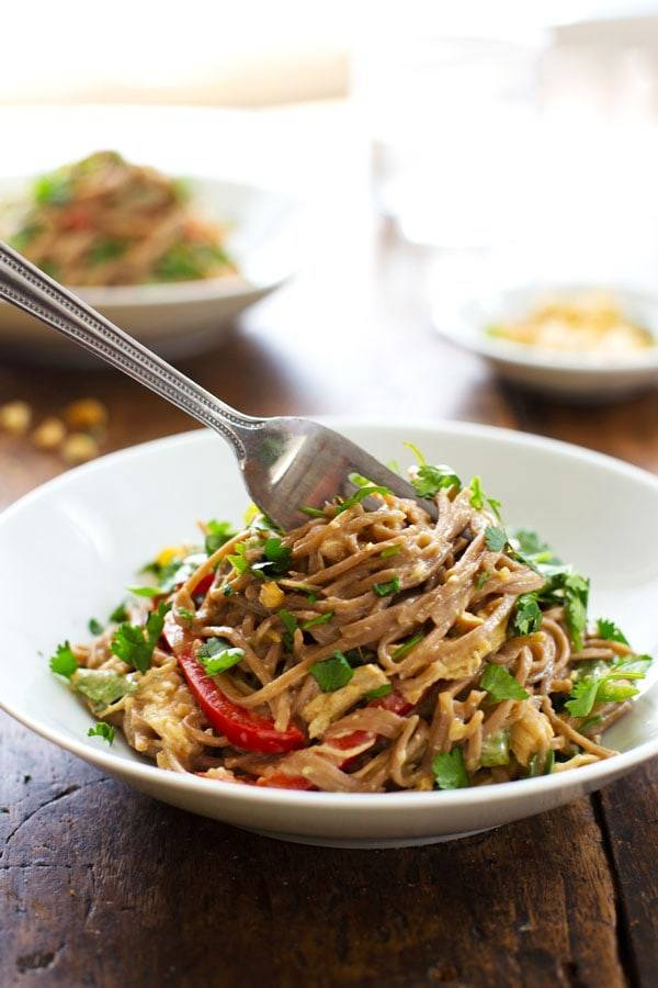 Peanut Chicken Soba Noodle Salad in a white bowl with a fork.