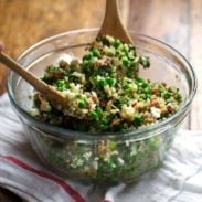 Spring Quinoa Salad with Honey Lemon Vinaigrette - peas, bacon, fresh herbs, almonds. Serve on spinach for fresh take-to-work lunches! | pinchofyum.com