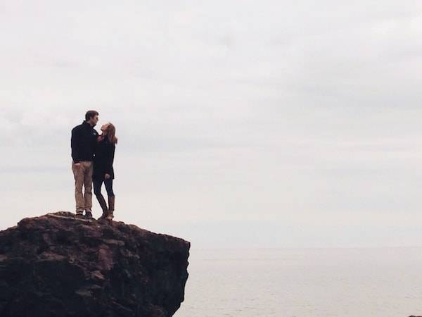 Man and woman on a small cliff.
