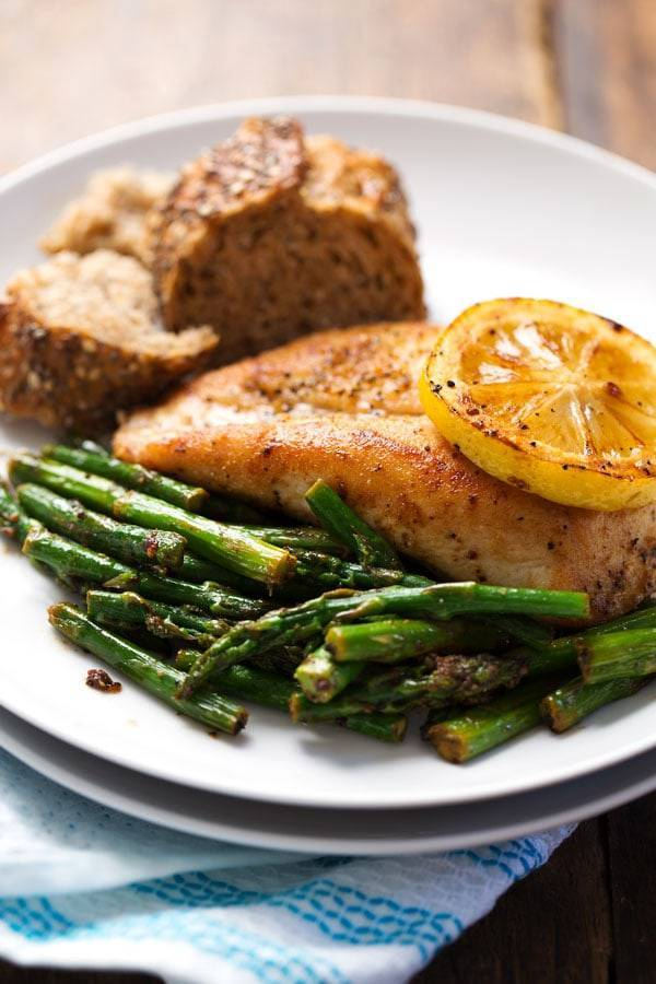 This 5 Ingredient Lemon Chicken with Asparagus is a bright, fresh, healthy dinner that comes together in 20 minutes! So good! | pinchofyum.com