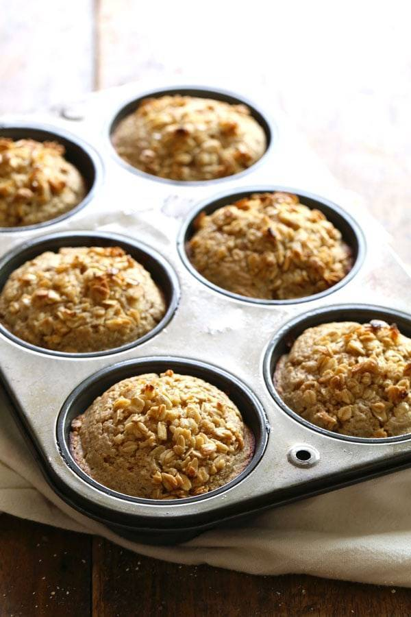 Caramelized Banana Oat Muffins in a muffin tin.