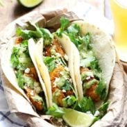 Crispy Fish Tacos with Jalapeño Sauce - beer-battered with a cornmeal crust for an extra yummy texture, plus the spicy-cool combo of that creamy jalapeño sauce. Summer food! | pinchofyum.com