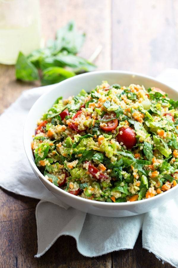 Herbed Quinoa Garden Veggie Salad tossed with a Lemon Herb Vinaigrette. Perfect for summer get-togethers! 200 calories, V/GF. | pinchofyum.com