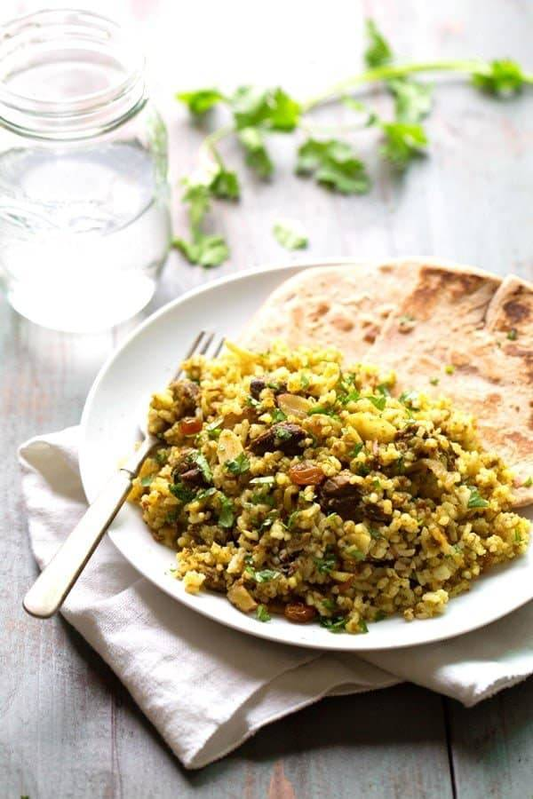 This Beef Biryani recipe includes toasted almonds, golden raisins, saucy beef, warm spices, and fragrant basmati rice. ❤ le sigh. 380 calories. | pinchofyum.com