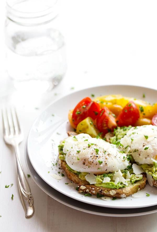 This Simple Poached Egg and Avocado Toast recipe is so simple and so delicious! Real, healthy food never tasted so good. YUM! | pinchofyum.com
