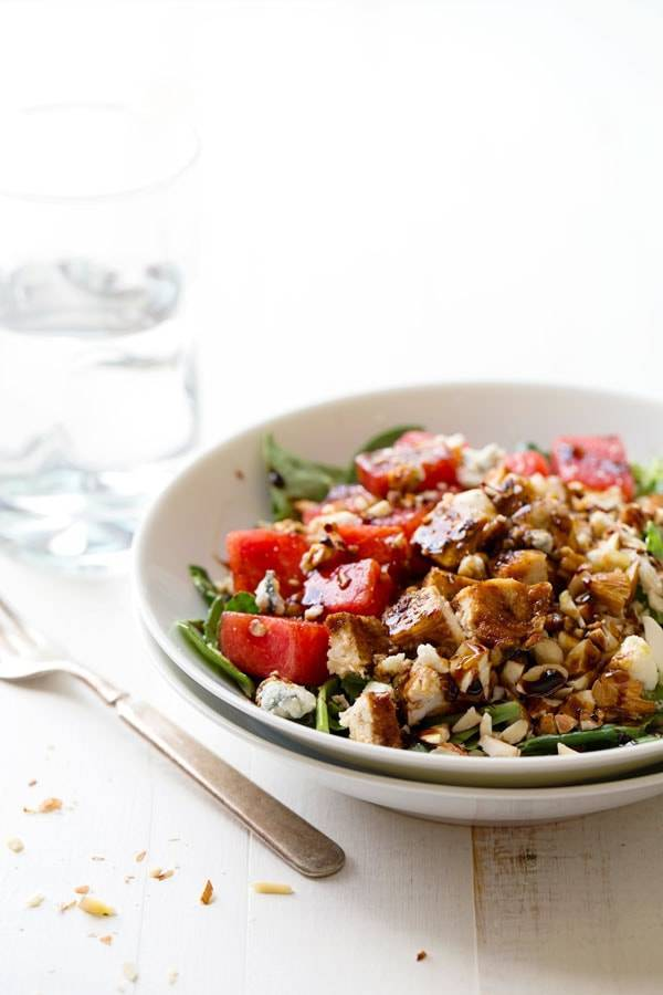 This Balsamic Watermelon Chicken Salad has blue cheese, watermelon, almonds, herbed chicken, and a balsamic glaze. Simple and fresh. | pinchofyum.com