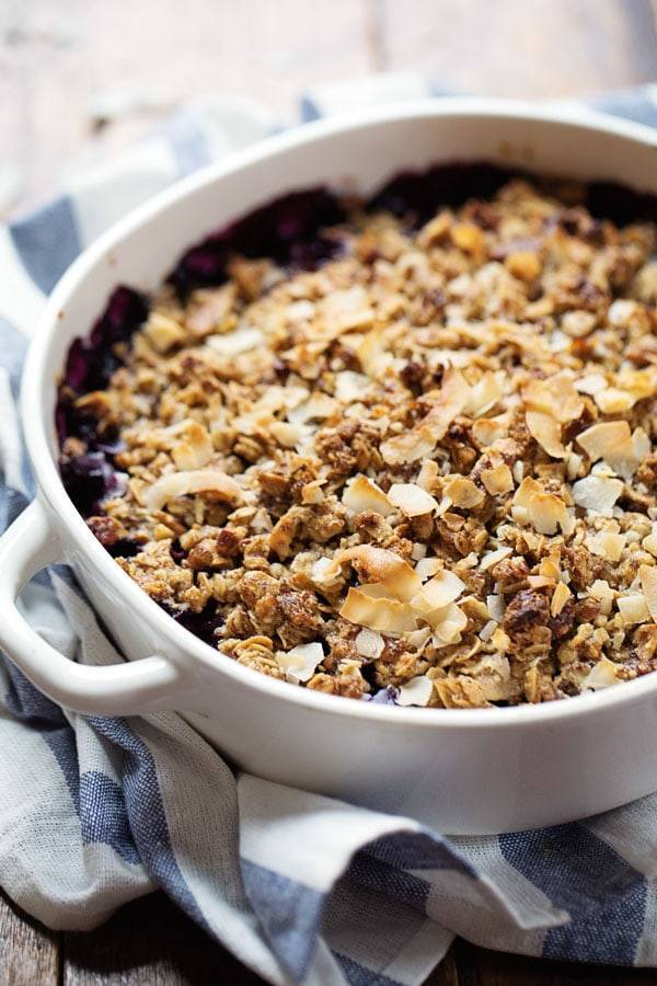Simple Oat and Blueberry Crisp in a white baking dish.
