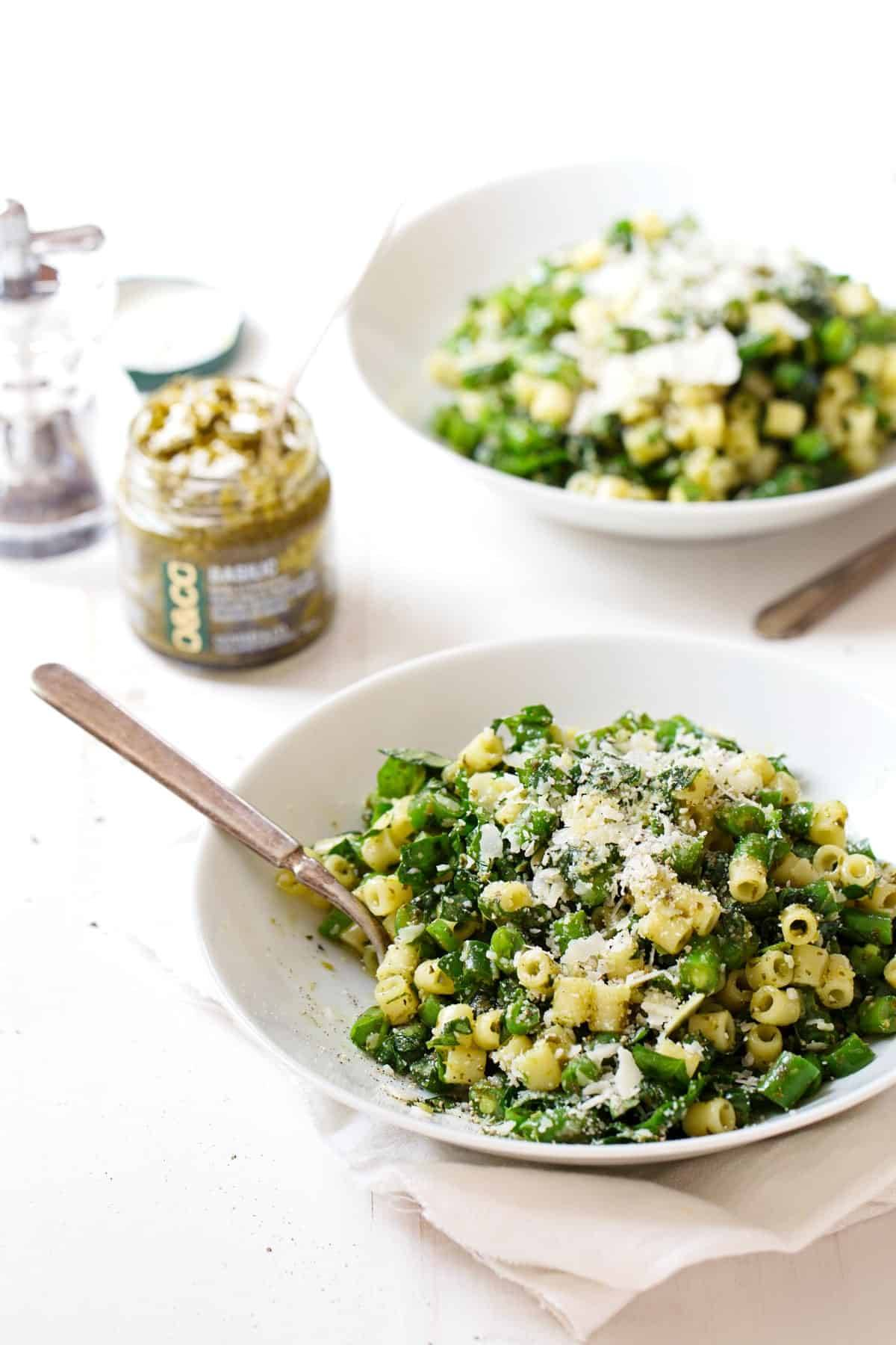 Green Pasta Salad on two plates.