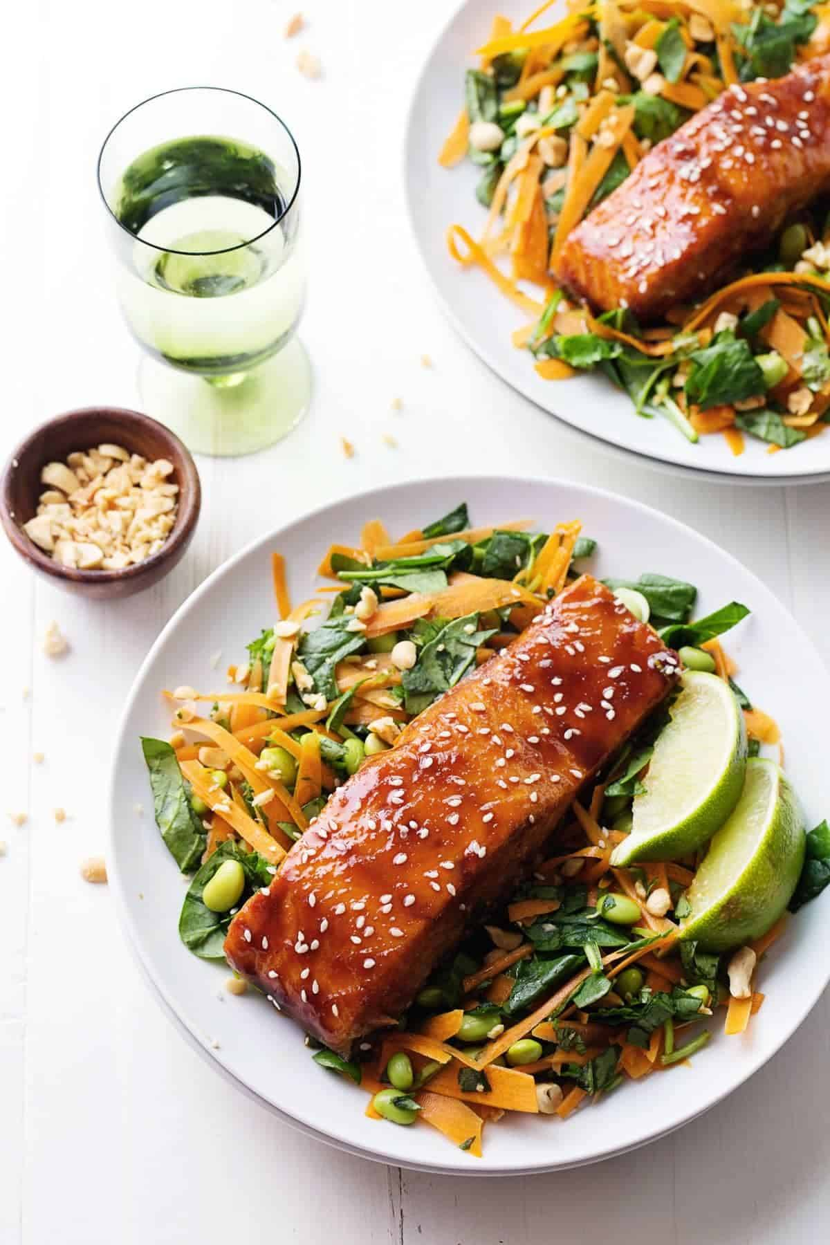 Glazed Salmon on top of green salad.