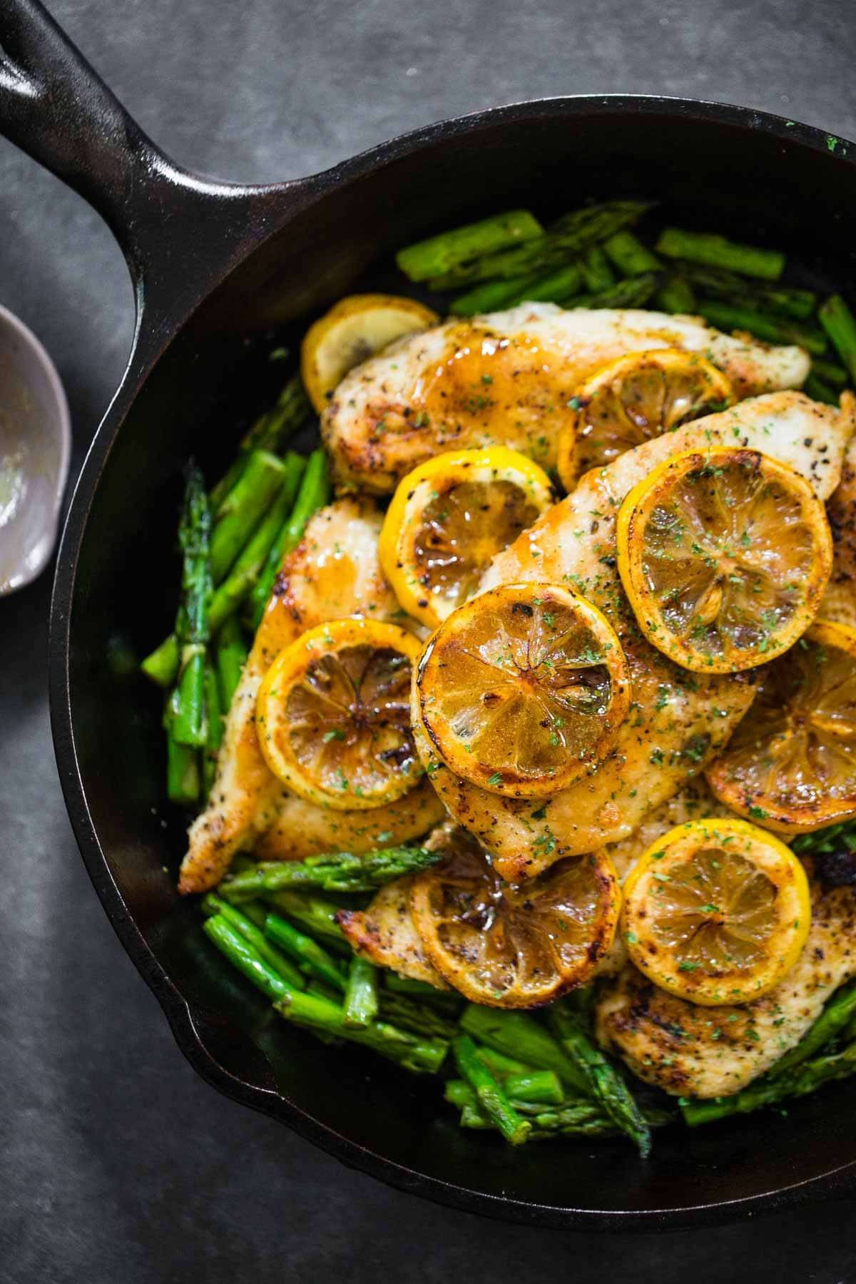 Lemon Chicken With Asparagus In A Skillet