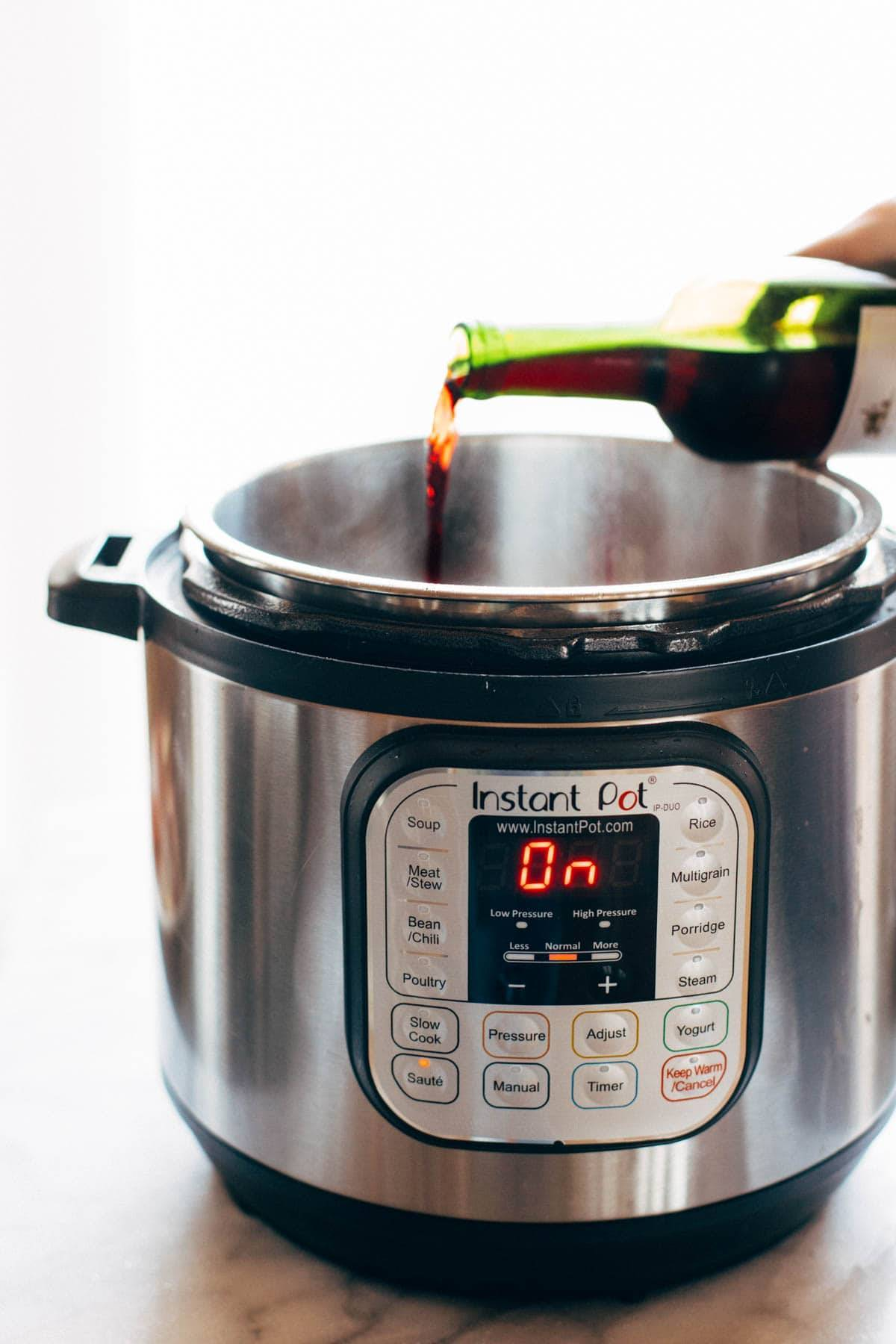 Wine poured into an Instant Pot.