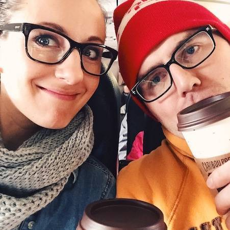 Man and woman wearing glasses in an airplane.